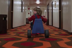 danny-riding-tricycle-the-shining-hotel